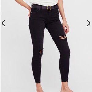 Distressed black Free People skinny jeans